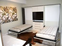 double white Murphy Bed on black metal couch combined by white