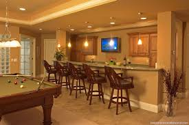 basement bar lighting. wet bar featuring slab granite counter alder cabinets and pendant lighting basement t