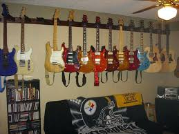 als wall hanging guitars on wall bad best guitar wall hanging storage ideas images on how hanging guitars on wall ideas