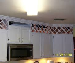 install a wine cellar above cabinets to get extra storage