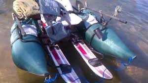 crazy inflatable pontoon with 6hp outboard motor in tahoochee river you