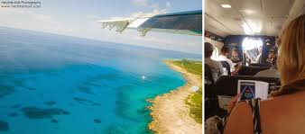 grand cayman living the dream. the trip over to this tiny 10x1 mile island is all part of experience. from grand you will get on a twin prop cayman airways express plane and fly living dream u