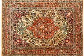 an early 20th century isfahan rug woven from kurk wool with fl scrollwork