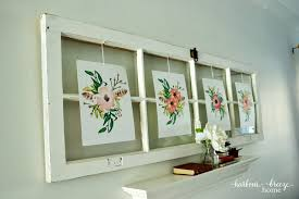 thumb into the underside of the old window frame once they were in place and holding i hung the printables up by the string hangers spring wall art