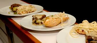 Plates of lobster alfredo and grilled ...