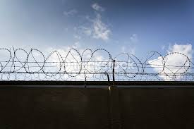 barbed wire fence prison. Prison Wall Barbed Wire Fence With Blue Sky Background : Stock Photo L