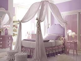 white wood canopy bed white wooden canopy bed with long white curtains also purple head board