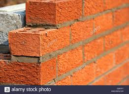 bricklaying wall red house bricks facing half cement breeze blocks building a block retaining wall in the uk
