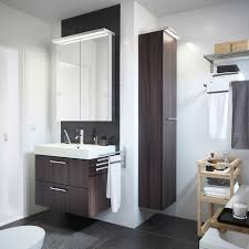black and white bathroom furniture. A White Bathroom With GODMORGON Sink Cabinet In Black Brown And MOLGER Trolley Birch. Furniture