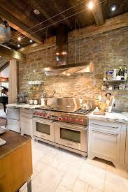 Photo 1 of 5 Ingenious Industrial Kitchen With Stone Wall And Marble  Countertops [Design: Jarrett Design] (