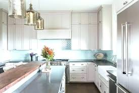 light blue backsplash plus light blue tile light gray kitchen cabinets with aqua mini glass tile
