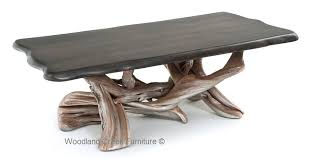 stump coffee table with ebony slab top