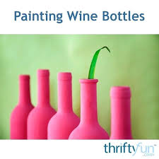 para spray paint wine or other bottles white let dry then light blue darker b painting with chalk