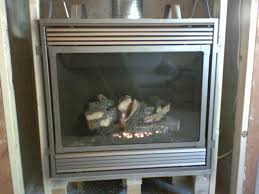 gas fireplace insert what to use underneath