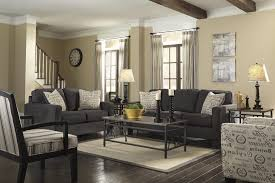 living room fabric sofa bed gray wall tv bench brown cream laminated wooden cabinet zebra skin
