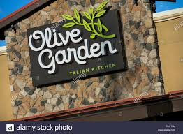 a logo sign outside of a olive garden restaurant location in harrisburg pennsylvania on february