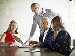 tips for successful teamwork coworkers in discussion at conference room table