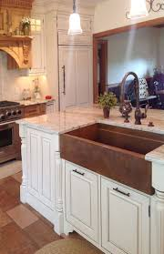 hammered copper kitchen sink: hundreds of photos of upscale kitchens showing copper and stainless steel sinks by rachiele get kitchen design ideas here