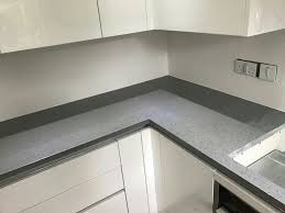 grigio scuro stella dark grey starlight quartz worktops with white high gloss kitchen