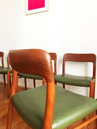 midcentury model  green leather dining chairs by niels o