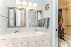 1 light over 2 mirrors in bathroom