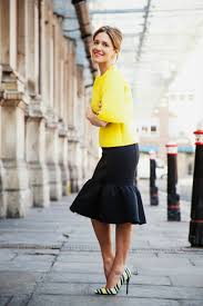Perfect spring and summer outfit...Yellow top, ruffled black skirt ...