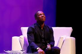 the multiplier effect mathematician daniele struppa brings a leslie odom jr looking up on stage