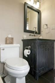 black rustic bathroom design with charcoal gray slate tiles floor rustic black bathroom chest vanity washstand black rectangular mirror and ivory stone