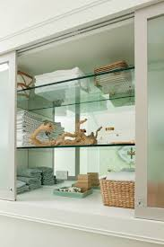 bathroom cabinet with glass shelves