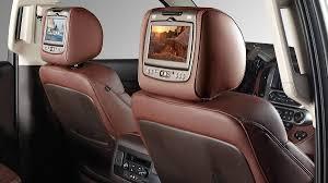 vehicle interior featuring rear facing headrest dvd video screens