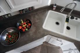 DIY concrete countertops over laminate surfaces using Henrys Feather Finish  is a fast, budget route