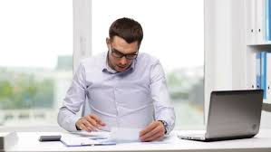 business people paperwork and technology concept busy businessman with laptop computer calculator