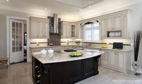 black island with white speckled marble countertop custom traditional cabinetry with the same beautiful countertop custom black backsplash