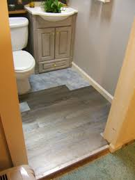 how to install floating vinyl plank flooring in a bathroom lay l and stick tile home installing laminate flooring around
