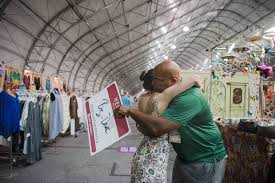big dave sylvester gives amanda canepa a hug at las vegas gift show
