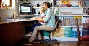 home ofice work home office. father working from home with son on his lap morsa imagesgetty images ofice work office s