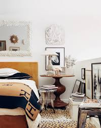 antique wooden round nightstand with leopard rug and white wall for bedroom decoration ideas