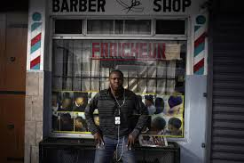 philocles julda 44 poses for a photo in front of a haitian barber in tijuana mexico thursday nov 22 2018 julda is part of a group of haitian