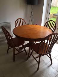 reduced round dining table and 4 chairs