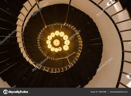 spiral staircase lighting. Ancient Spiral Staircase In A Tall Tower With Lamp Light \u2014 Photo By Tofumax Lighting R