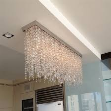 4 fixture with hanging crystals installed over kitchen counter in upper east side nyc