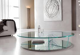 amazing round glass coffee table feat abstract wall art with white leather sofa and throw blanket plus modern torchiere floor lamps