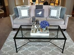 living room unique glass table with black frame on the light grey