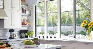 sunny modern kitchen with windows overlooking sink
