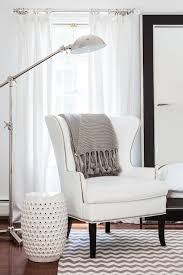 white wingback chair. Adore Magazine - Bedrooms Bedroom Reading Corner, White Curtains, Wingback Chair, Gray Throw, Throw Blanket, Ch. Chair