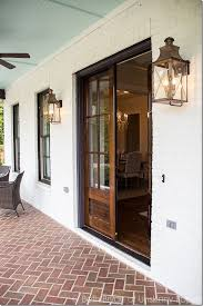 front porch goals love the double wooden front doors and the porch light lanterns