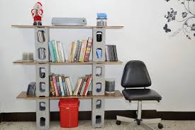 The bookshelf makes use of the most commonly used materials in modern  construction -- wood and concrete blocks.