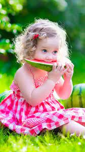 Cute Baby Girl Is Sitting On Green ...
