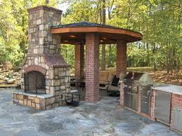 double sided outdoor fireplace double sided outdoor fireplace landscape traditional with chimney custom image by masonry