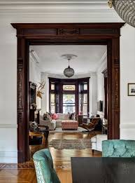 the mix of white trim select dark trim highlights the best woodwork while lightening up the e